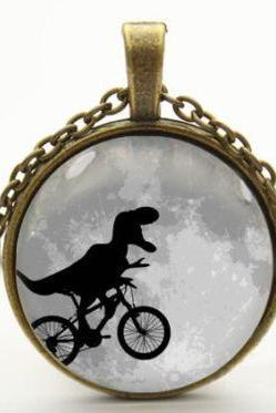 dinosaur on bike necklace pendant jewelry